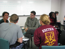 Professor Karl Haushalter discusses a reading with students