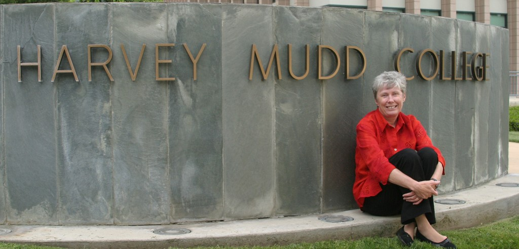 President Maria Klawe in front of HMC sign.