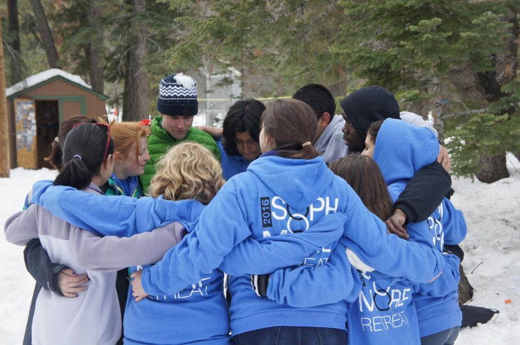 Sophomore Retreat participants stand in a circle.