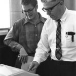 Jack H Waggoner discusses work with a student.