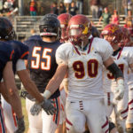 Paul Slaats '17, CMS football player greets opponents
