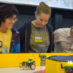 students competing in robotic vehicle competition