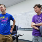 Kyle Lund and Sam Dietrich in Professor Jim Boerkoel's classroom