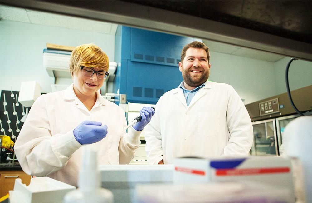 Professor of Biology Dan Stoebel with student