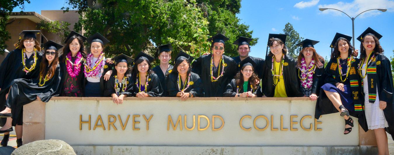 graduates by harvey mudd sign