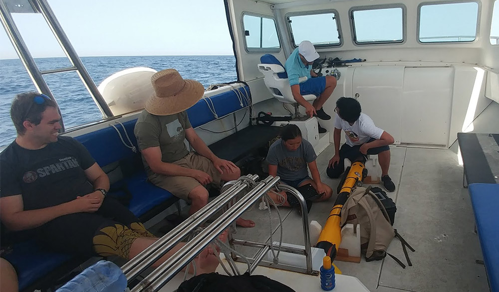 students with AUV in boat