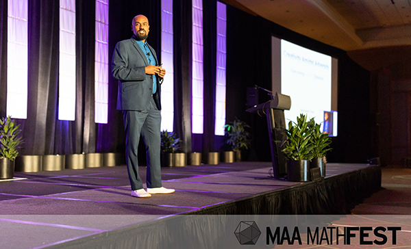 Harvey Mudd math professor Mohamed Omar delivering address at 2018 MathFest. Photo courtesy of Mathematical Association of America.