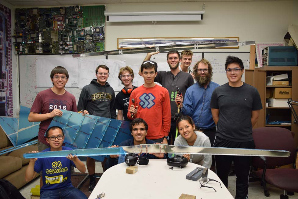 Student and faculty team and airplane pieces