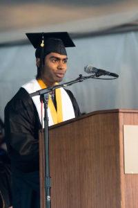 Student keynote speaker at podium