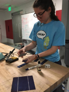 student working with solar panel