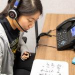 student tutor taking call
