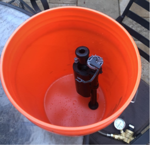 Fluidmaster team members have replicated the toilet tank environment in their backyards to enable testing.