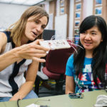 professor and student in CS lab