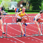 Track and field alumna Katie Ray, Class of 2002, jumps hurdles for CMS