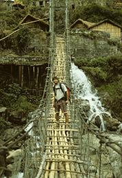 Harvey Mudd Watson Fellow Alan Baron on a suspension bridge in Nepal