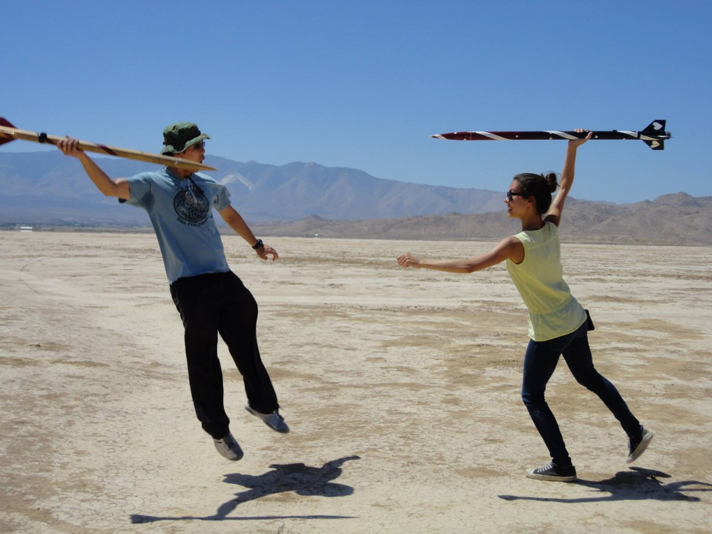 Ivan '15 (left) flies away as Cassandra Meyer '15 (right) charges forward with her E80 rocket.