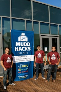 Ben, Appi, and Akhil stand by their banner the morning that the hackathon entries were judged.