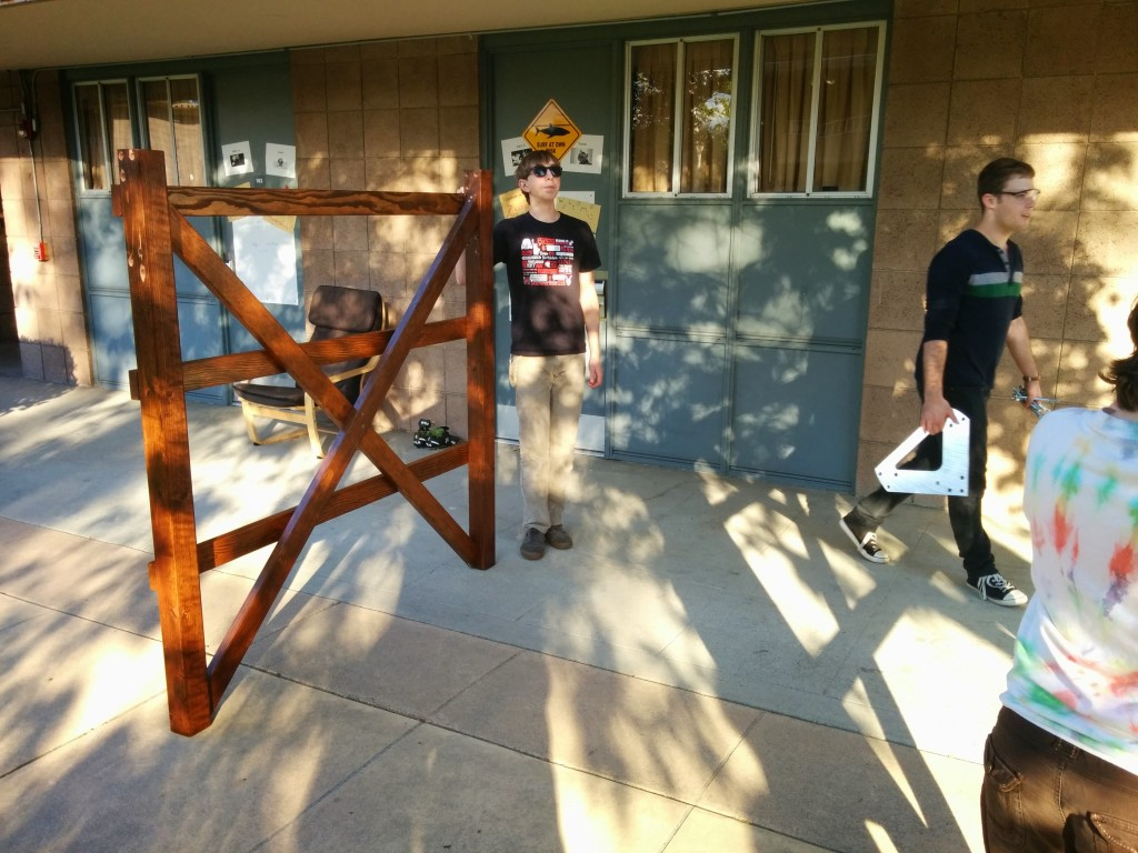 Andrew Bishop '18 leads the carpentry effort.