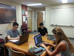 The table at the junction of the Physics and Chemistry Departments is a popular work spot amongst physics majors and freshman alike. Here, Jim Wu, Tim Middlemas, and Rachael Kretsch work on summer research. Prof. Cave's office door is open behind them (fun fact: Prof. Cave is a chemist, but his office is in the Physics Department. He was the one who converted me to physics, too!)