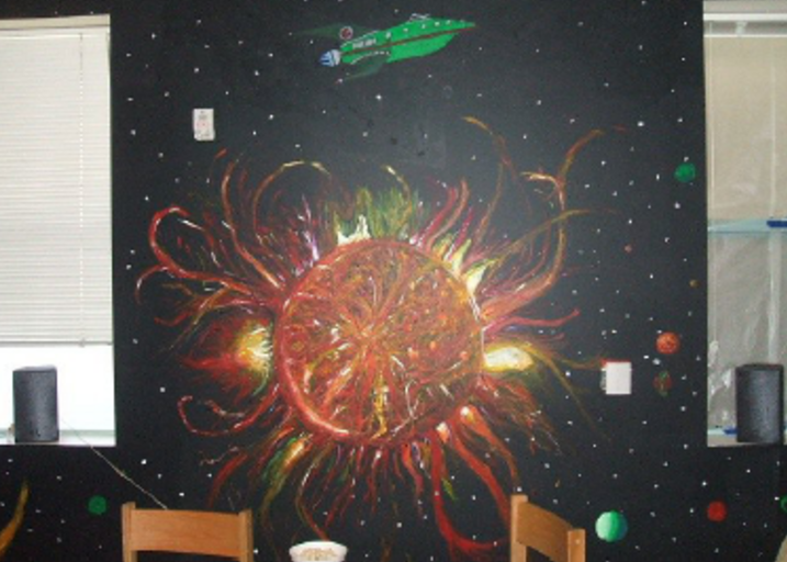 A mural of a star and a spaceship