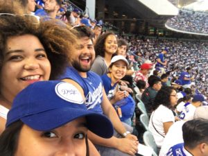 A group selfie in the bleachers at a Dodgers game