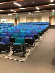 Rows of blue and green upholstered chairs