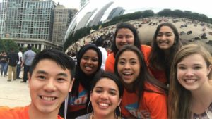 "A group selfie in front of Chicago's fampus ""bean"""