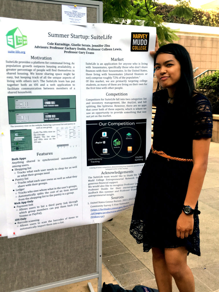 "Giselle stands with the ""Summer Startup: Suite Life"" research poster."