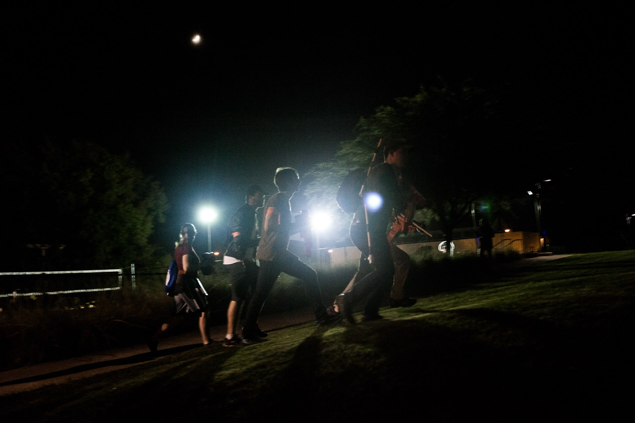 Students running around in the dark during a night mission. Photo credit: Liam Brooks