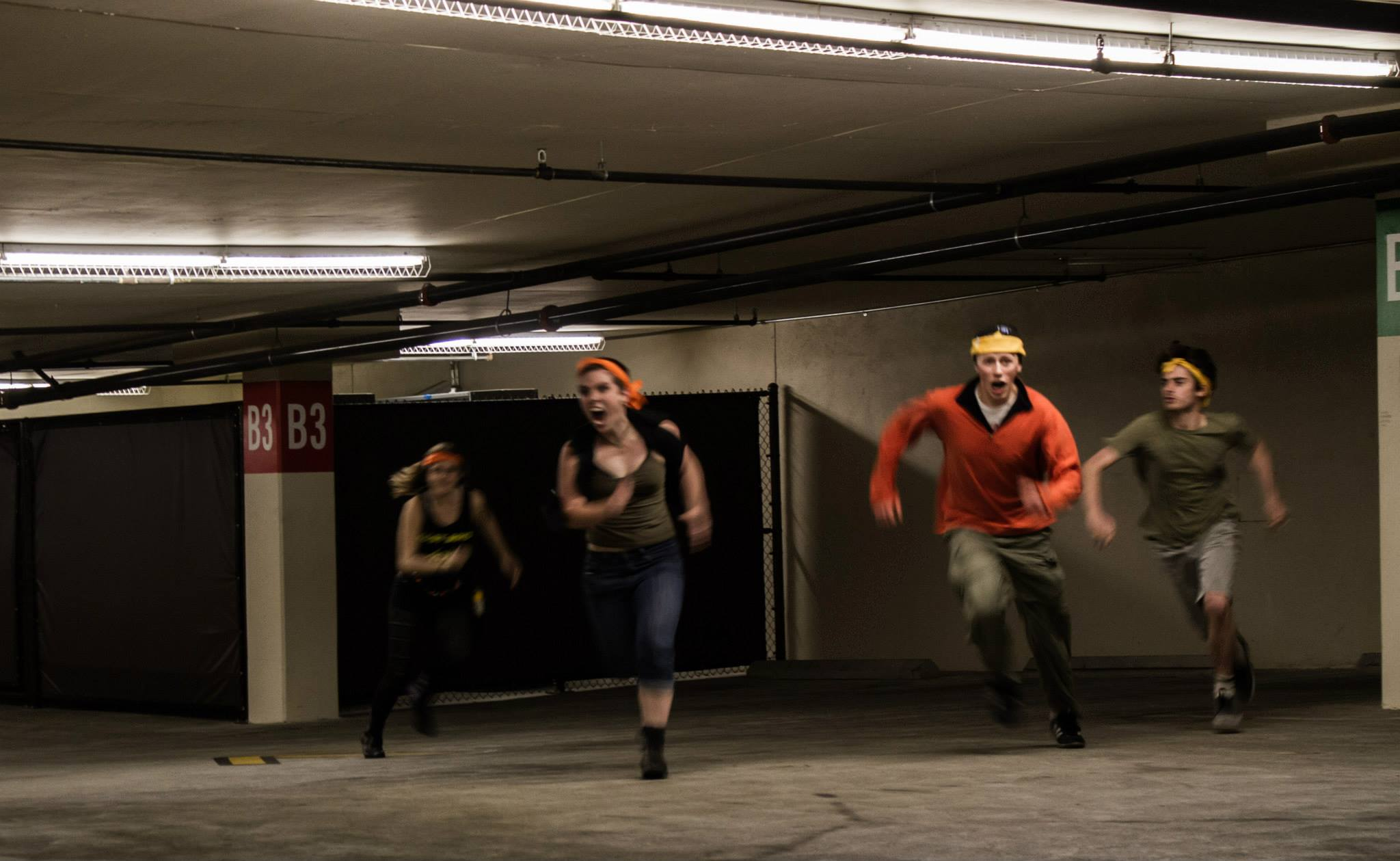 Students running in a parking structure during the Fall 2014 game of HVZ