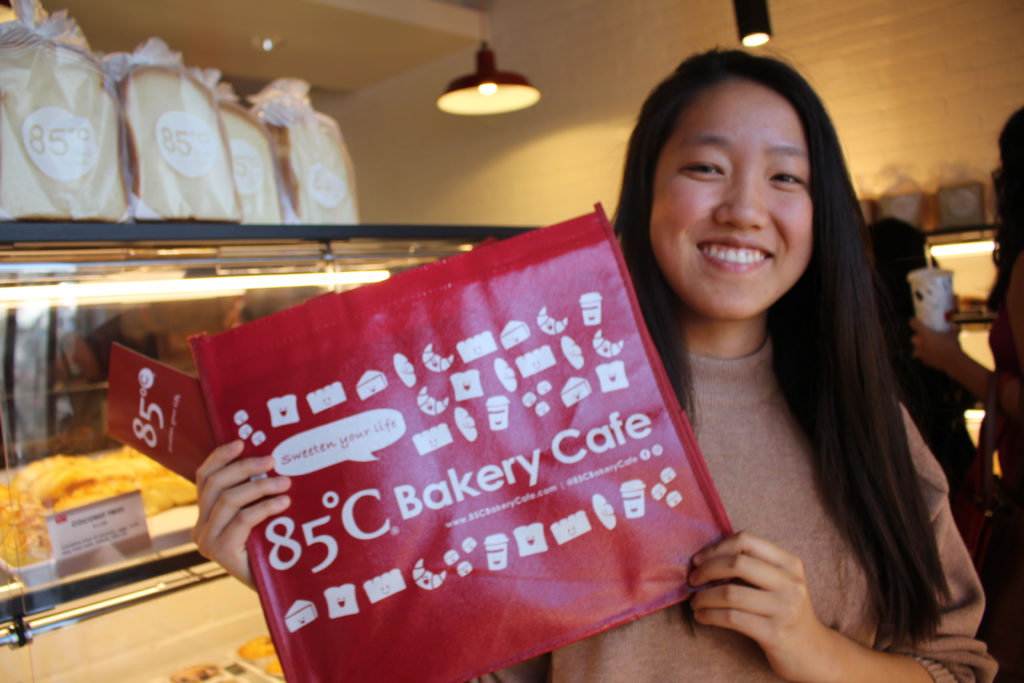 Cathy posing with a bag from the new 85 degrees bakery in Claremont