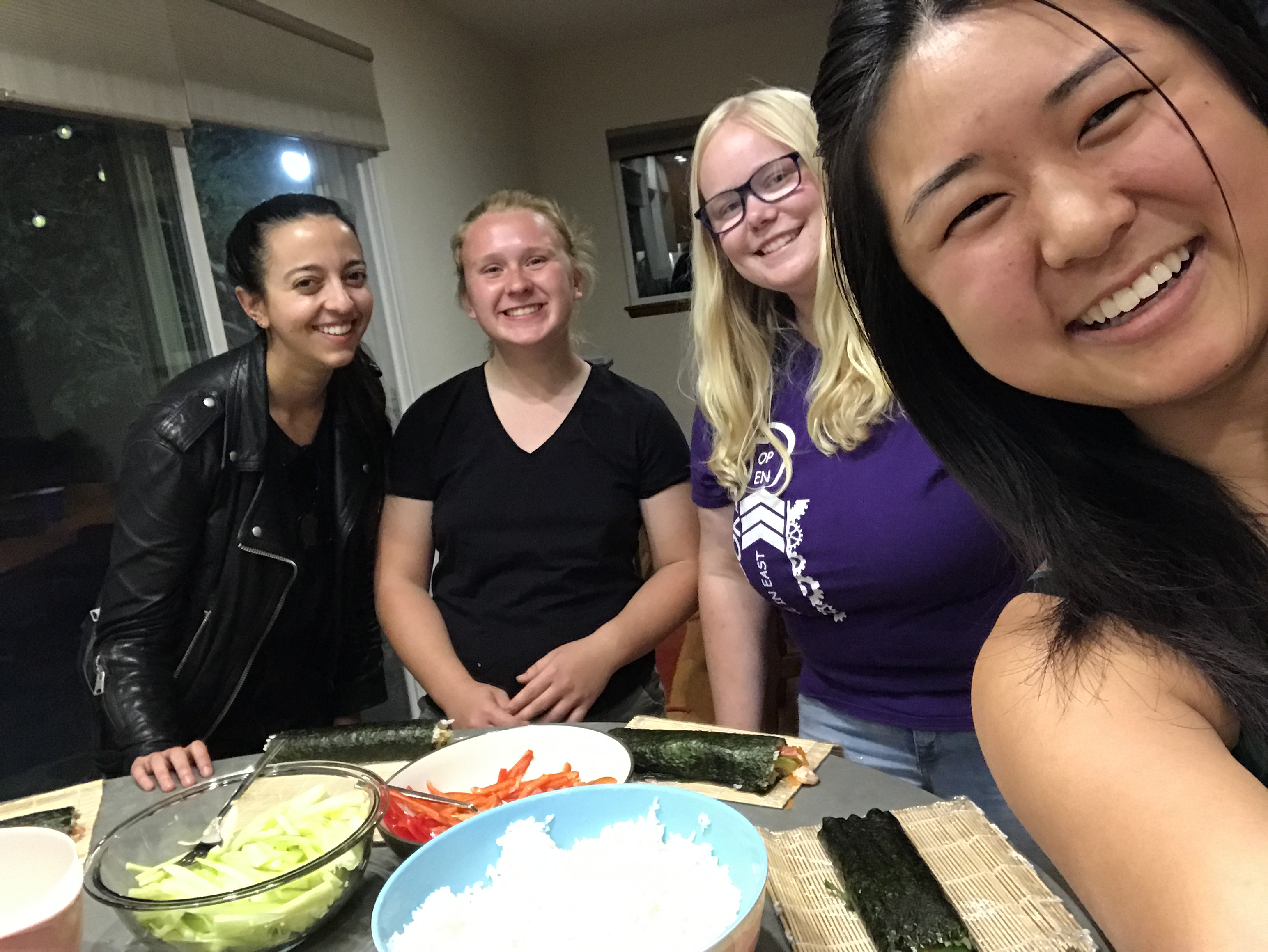 Sarah (Class of 2018), Autumn (Class of 2021), Sara (Class of 2019), and I pose for a selfie with our homemade sushi rolls!