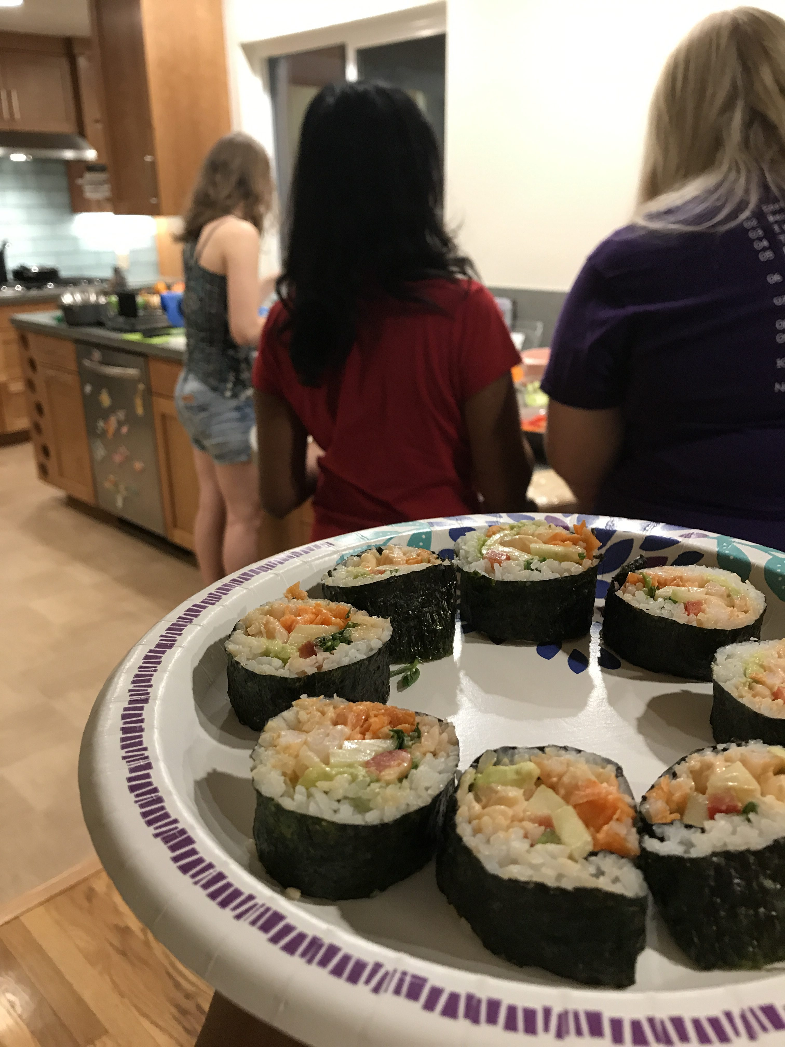 My homemade carrot, cucumber, pepper, watercress, and spicy shrimp sushi rolls