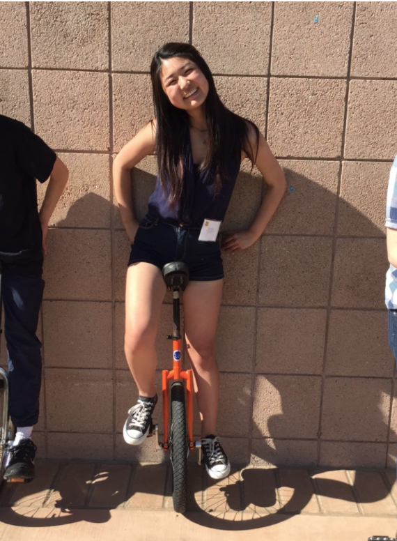 Julia learns to unicycle at the 2016 Admitted Student Program
