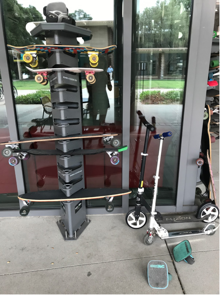 A skateboard rack outside the cafe of one of our academic buildings keeps boards, freelines, and scooters organized while students are diligently attending classes.