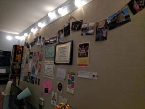 Atwood rooms have an entire wall made of work. Sienna decked hers out with certificates, photos, and string lights.