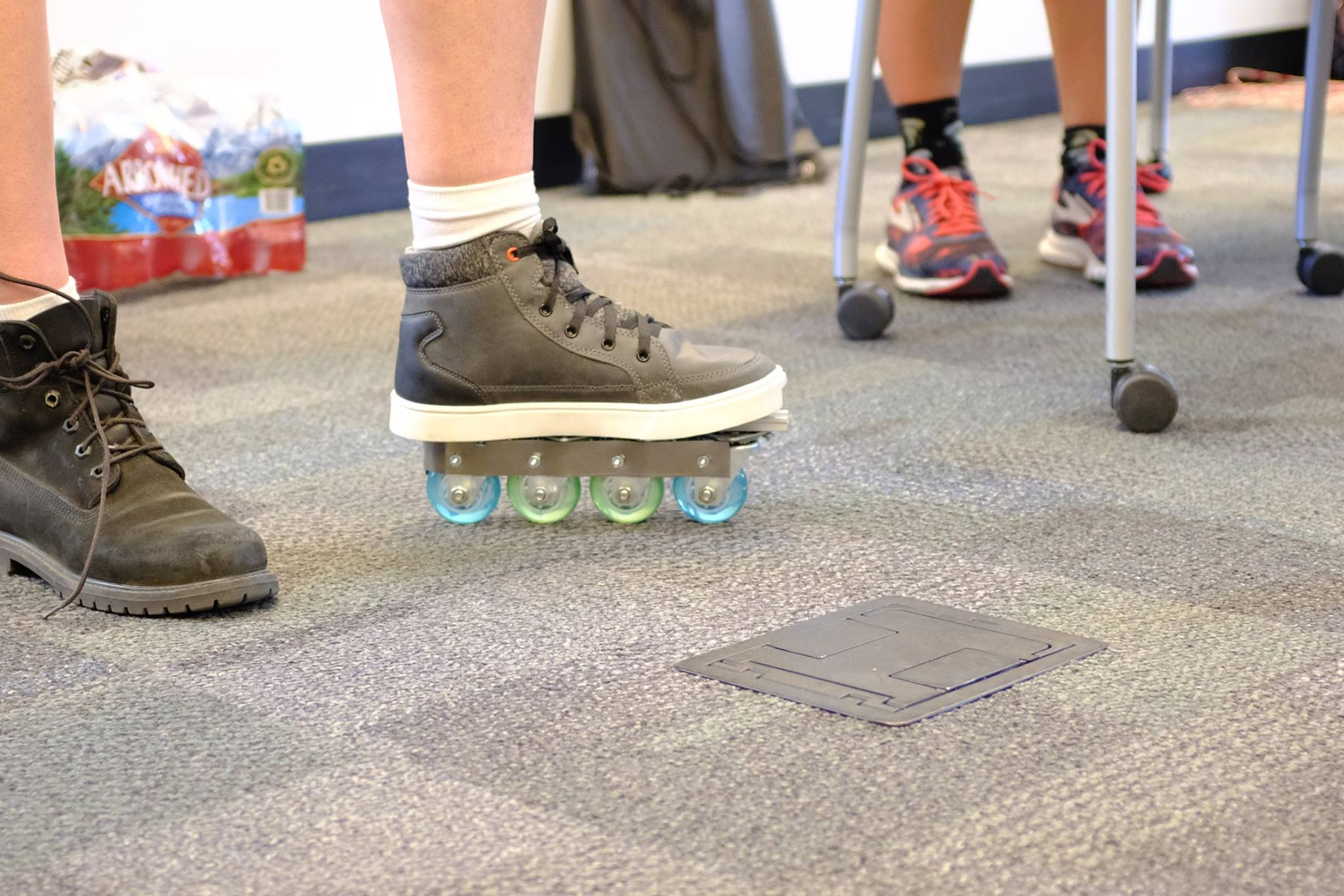 A close-up of the slip-on rollerblades, affixed to a student's shoe.