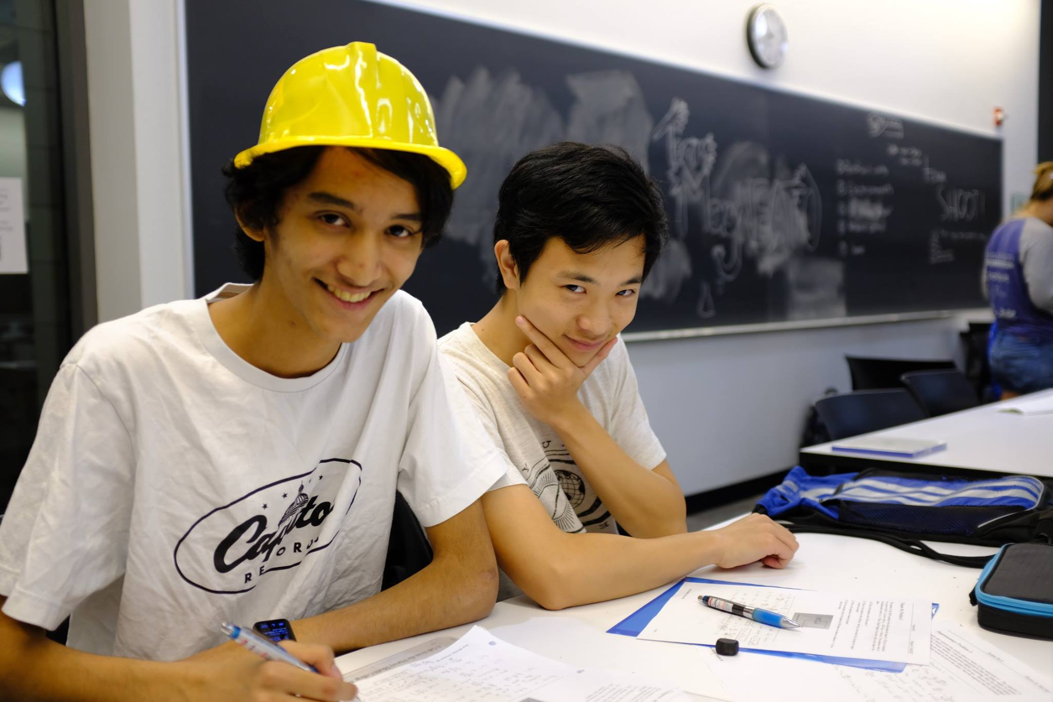 Two students pose for a photo at the hackathon