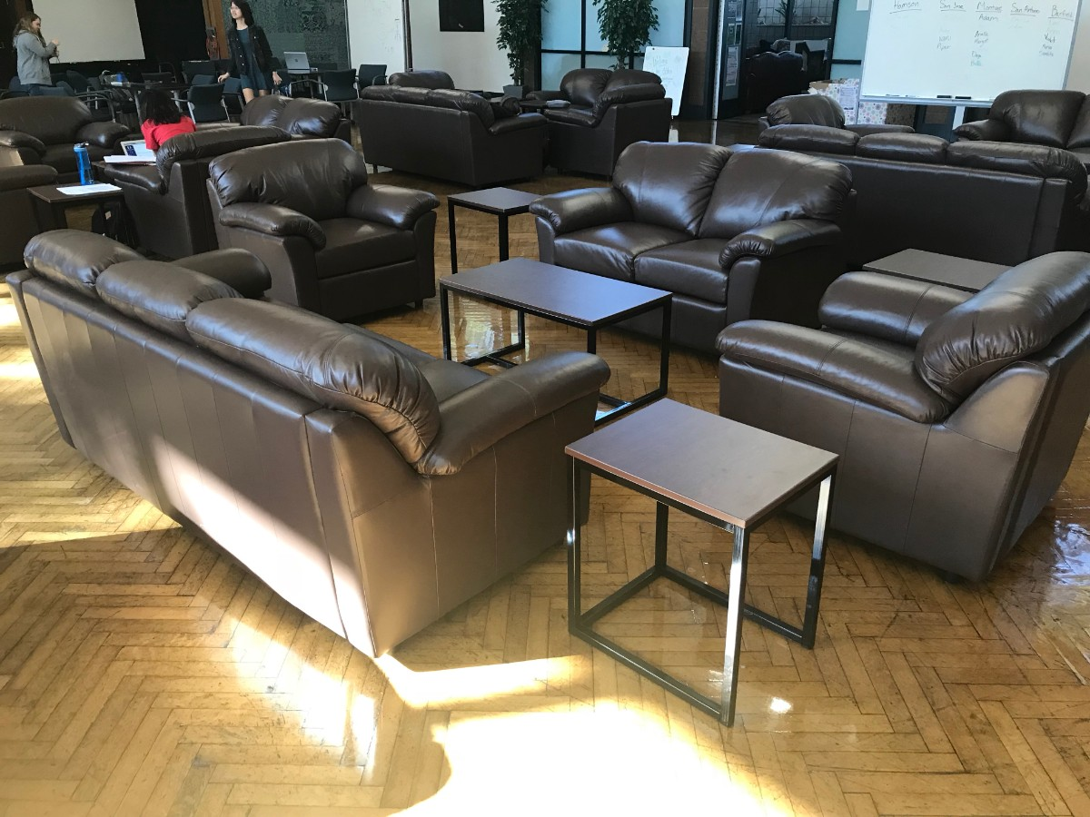 A wide shot of the new Platt setup: Blocks of sleek black couches and minimalist tables