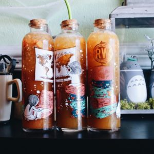 Collectible glass bottles from Roasting Waters with cute art