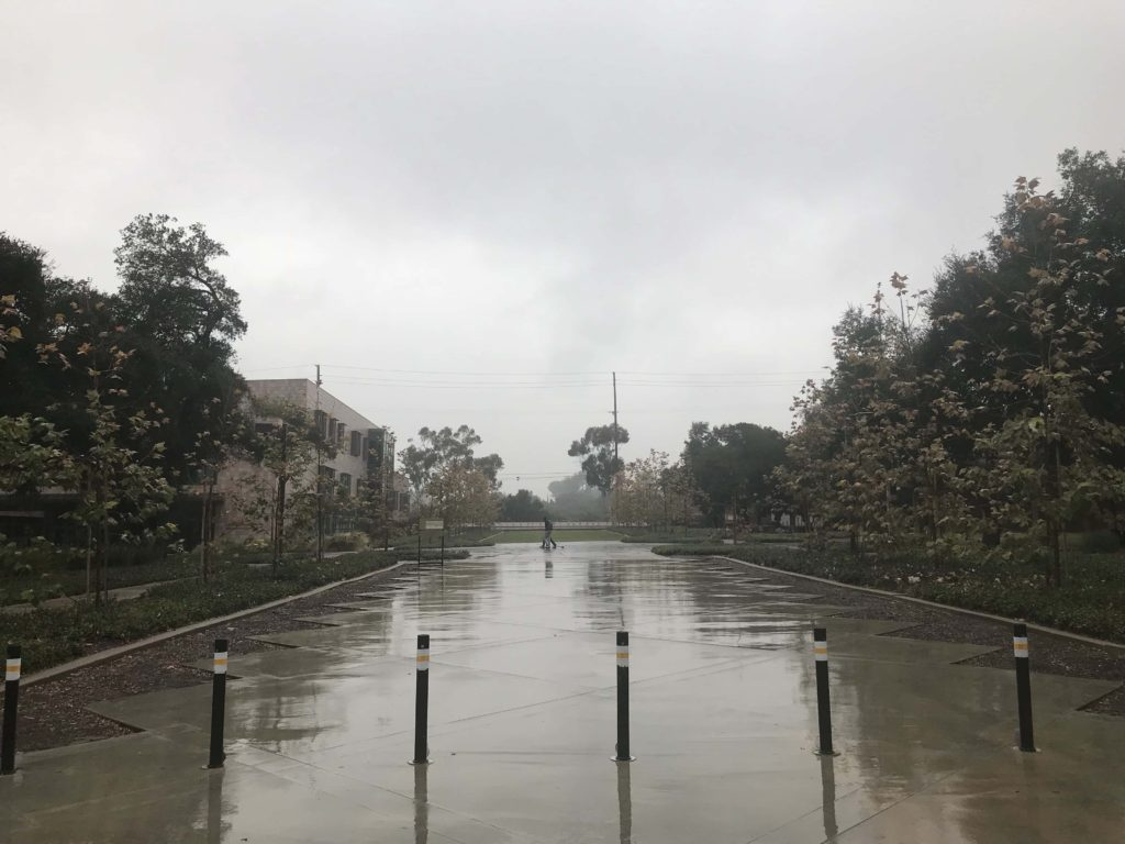 A shot of Harvey Mudd's central quad, the ground slicked with rain.