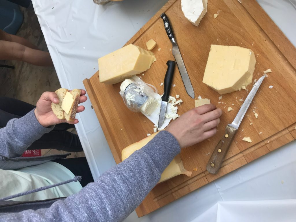 A picture of cheese on a cutting board.