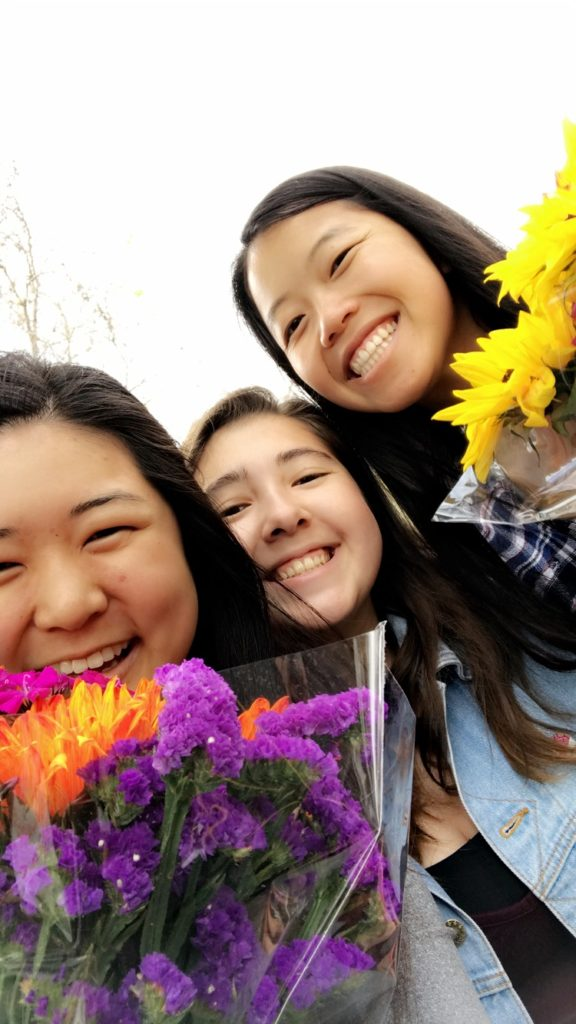 Julia and friends with flowers at the market