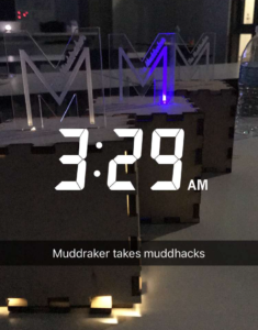 "Three wooden boxes with plexiglass ""M""s standing on top sit on a table. Text on the image says ""3:29AM"""