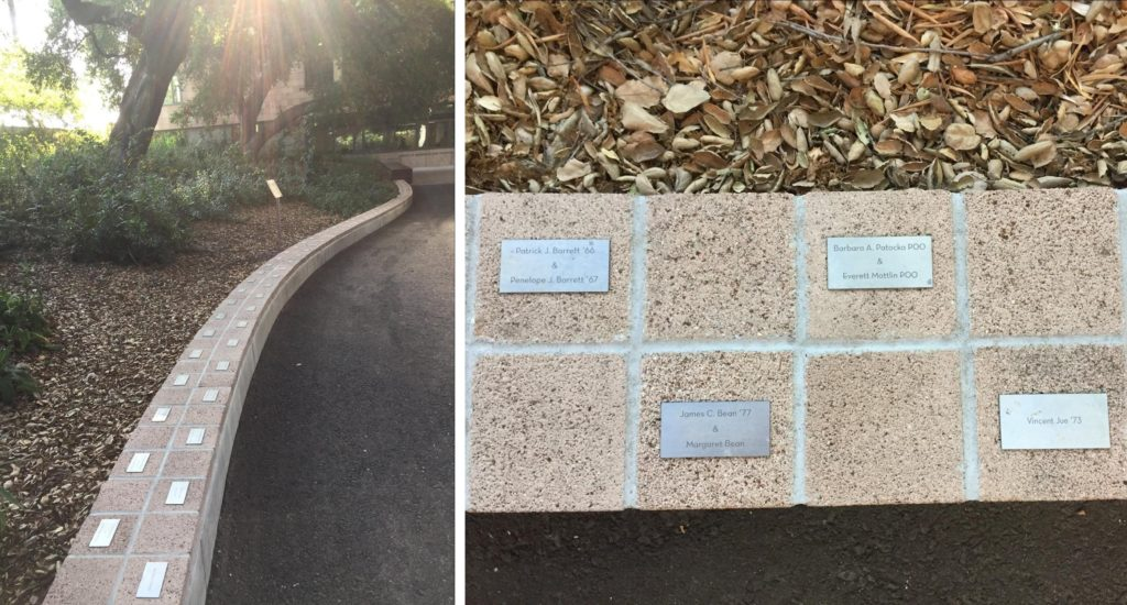 Left: A concrete pathway and a tree lined garden are separated by a short concrete wall covered in reddish square prisms Right: A close-up photo of some reddish-brown square prisms with plaques on them