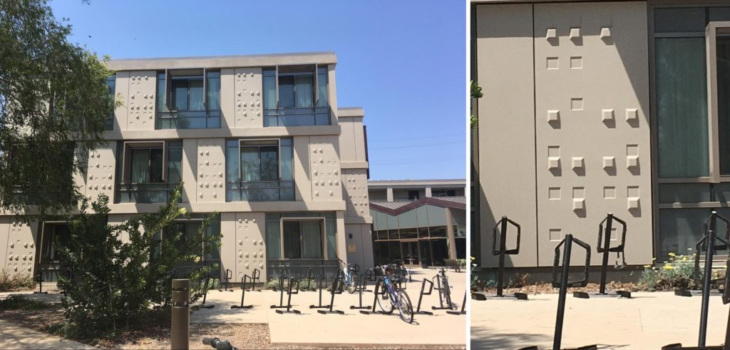 "Left: A wall of a building. There are alternating windows and panels of raised and indented squares, called warts. Right: One panel of the wall has lots of raised and indented squares. If you read them as braille, they will spell ""MUDD WART"""