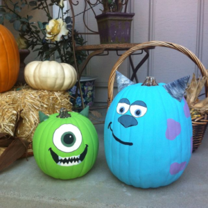 The picture features two pumpkins painted to look like monsters.