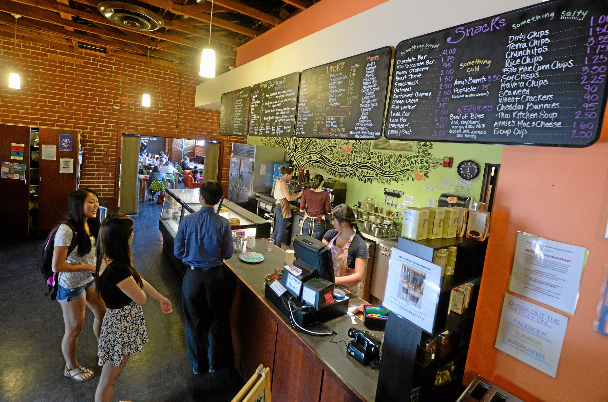 Students at Scripps College in Claremont wait for their drink orders at The Motley coffee house.