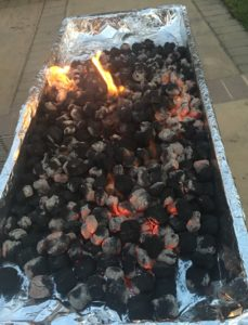 Whereas the previous pictures show the coal in a huge mound, this picture shows the coals laid out, without mounding/stacking. Nearly every coal has gray patches at this point.