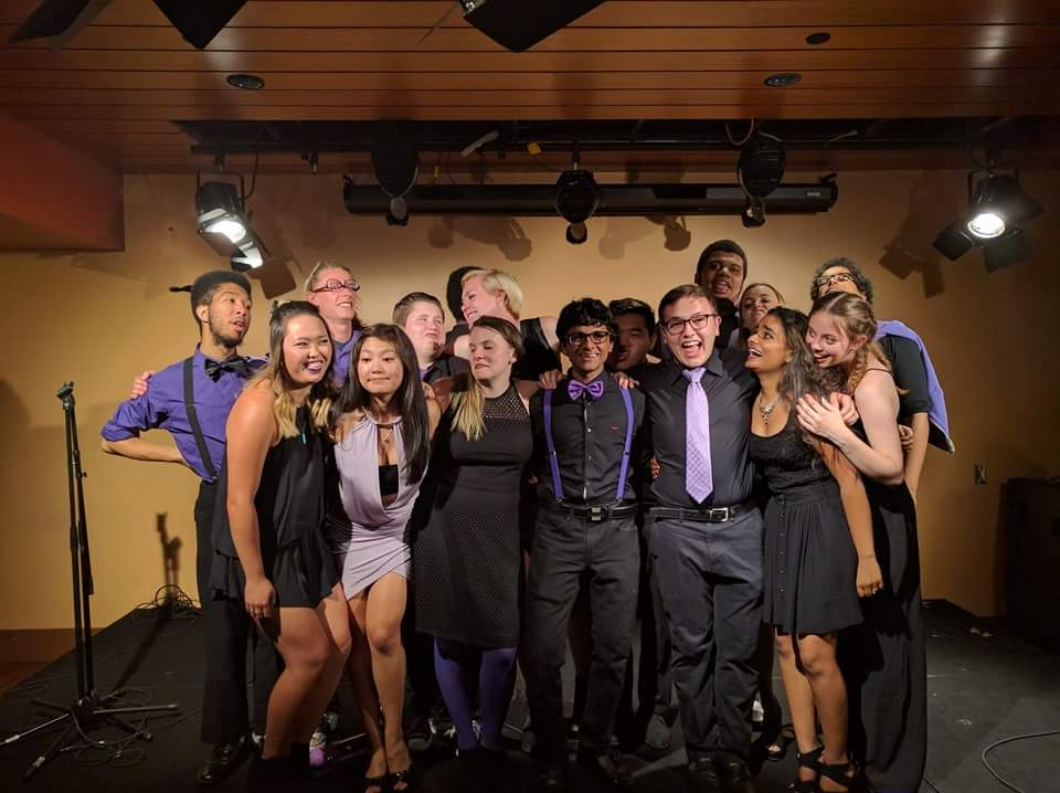 The Hooligans in concert dress huddled together onstage after our final concert.